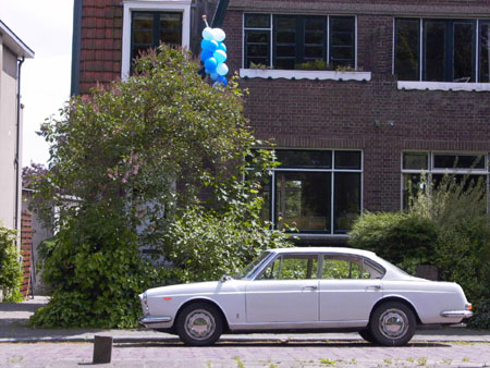 "Lancia Quattroporte: ""This Flavia Berlina Pininfarina fake is made from this photo of my Flavia in front of our house. The picture was shot when our son was just born, hence the baloons."""